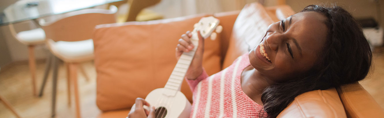 Woman smiling with guitar